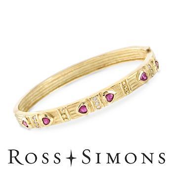 C. 1990 Vintage .90ct t.w. Ruby, .20ct t.w. Diamond Heart Bangle Bracelet. 7